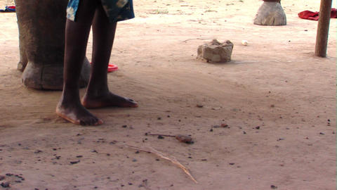 African woman sweeping the ground Footage