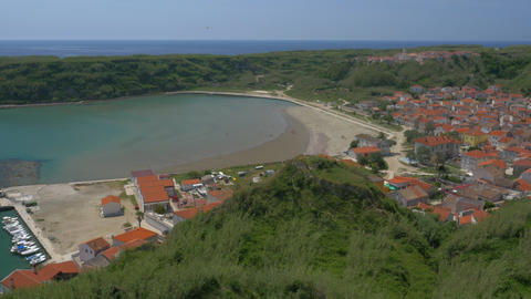Aerial - Lower and upper village of Susak by the sandy bay Footage