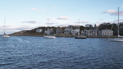 Shot of boats moored in Rockport Harbor in Massachusetts Footage