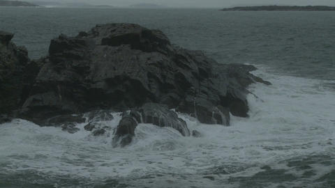 Waves crashing on a rocky outcropping in Maine Footage