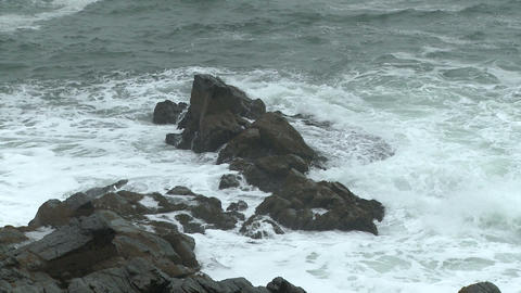 Waves breaking on rocks near Portland Head Light Footage