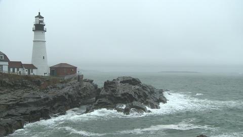 Pan across foggy, rainy seascape at Portland Head Light Footage