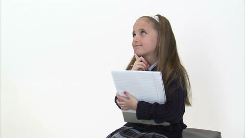 Royalty Free Stock Footage of Young girl doing homework on white Footage