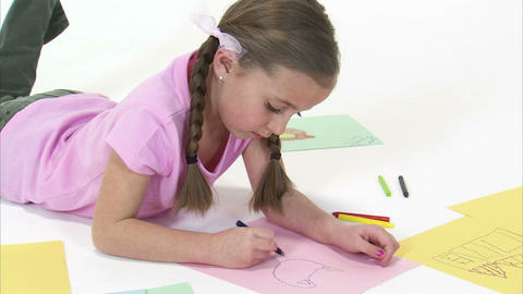 Royalty Free Stock Footage of Young girl drawing with crayons with white backgro Footage