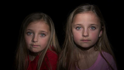 Royalty Free Stock Footage of Young twin girls staring at the camera Footage