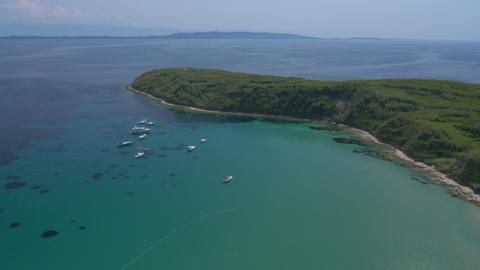 Aerial - Luxury yachts and sailboats anchored in a bay of Susak island Footage