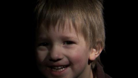 Boy playing peek-a-boo Footage