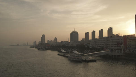 Panning shot of a Chinese cityscape from a bridge Footage