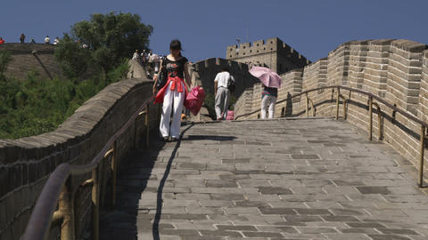 Woman walking down a decline at the Great Wall of China Live Action