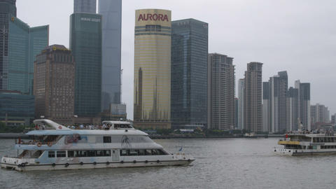 Boats floating by a harbor in Shanghai China Footage
