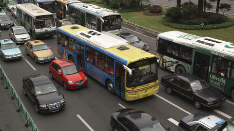 Close-up of busy traffic in downtown Shanghai China Footage