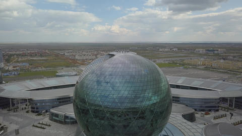 The building in the form of a ball on the background of the countryside Footage
