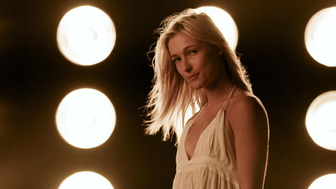 Beautiful Woman In Front Of A Wall Of Lights Footage