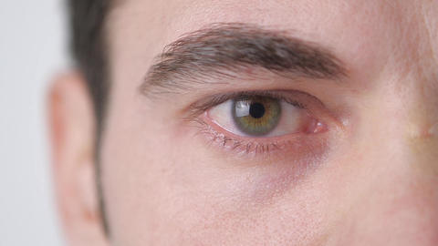 Close up of a Man's Eye. The pupil narrows in slow motion Live Action