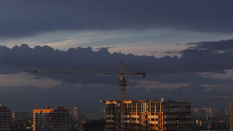 Time lapse of construction at sunset with city in the background Footage