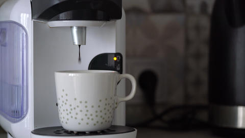 Home capsule coffee machine prepares a cup of fresh coffee. Cloud of steam at Footage
