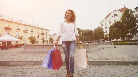 Modern woman shopper in urban city concept. Modern rich young woman smiling Footage