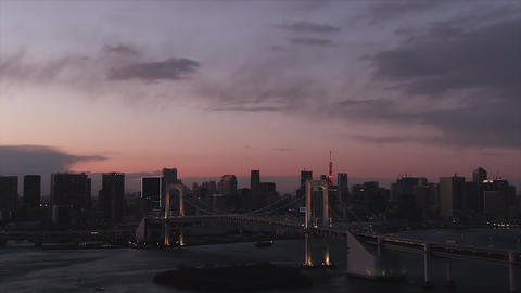 Cityscape of Tokyo and the landscape of Tokyo Bay at dusk - Zoom out GIF