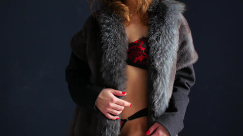 Beautiful woman in fur and lingerie. Close-up of lying sexy woman with perfect Footage