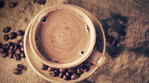 Cup of coffee with coffee beans, Live Action
