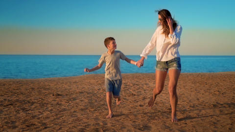 The mom and son run by the sea by the hand Footage