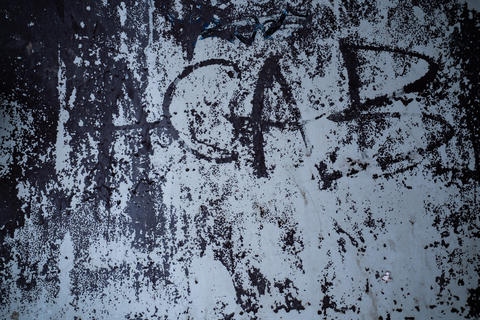 A dirty wall with a ACAB word written on a grunge area Fotografía
