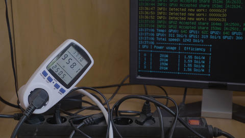 Gpu rig power consumption of crypto currency mining rig connected to power meter Footage