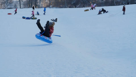 jumping on a sled on a snowy hill Footage