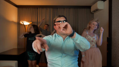 Cheerful nerd male with glasses dancing and partying Live Action