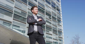 Smiling Young Businessman Portrait Standing Arms Crossed By Office Buildings Footage