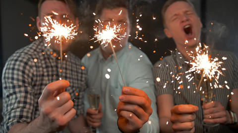 Sparkles. Birthday Celebrating by Attractive Young Guys Footage