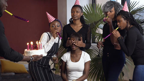 Emotional african friends making surprise party to their female friend Live Action