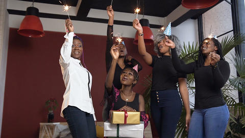 Five happy african girl celebrating with bengal lights, dancing during birthday Footage