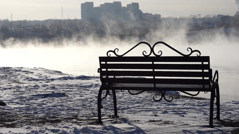 Bench in the fog on the background of the city Footage