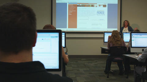 Wide shot of students in a college computer lab Footage