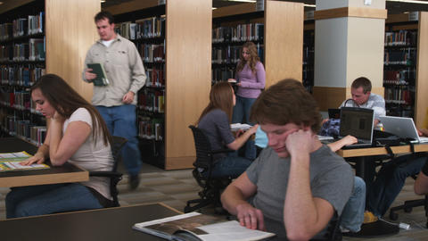 Wide shot of students studying at a library Live Action
