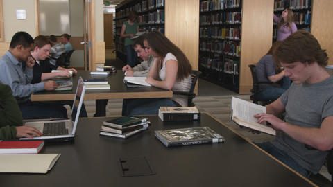 Shot of students studying at a library Live Action