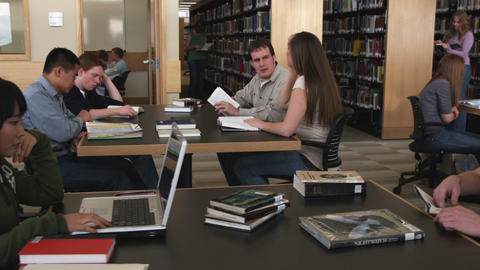 Clip of students in a library studying Footage