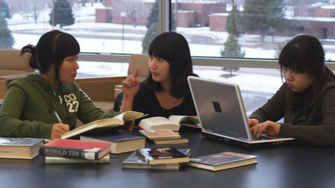 Dolly shot of international students studying Live Action