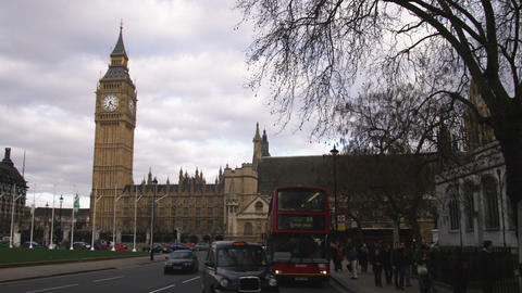 Traffic passing by Palace of Westminster in London Footage