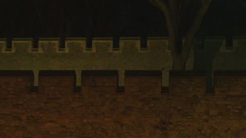 Panning shot of a castle wall at night Footage