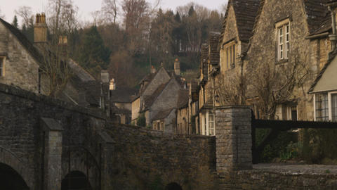 Old stone village with an old bridge in England Footage