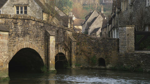 Tilt from a bridge to an old village in England Footage