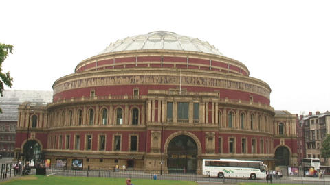 Cars drive past Royal Albert Hall in London Live Action