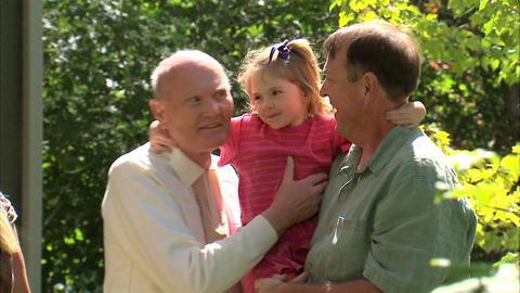 Grandpa giving a hug goodbye to his granddaughter Footage
