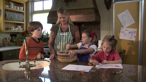 Children helping their mother prepare food Footage