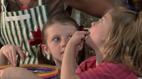 Little girl tasting food that her family is preparing Live Action