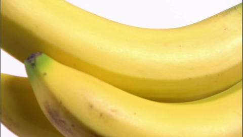 Close shot of bananas rotating on a white screen Footage