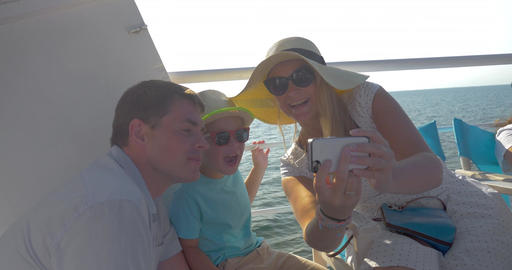 Family making mobile selfie on the ship Footage