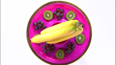 Shot of an assortment of fruit on a rotating plate Live Action